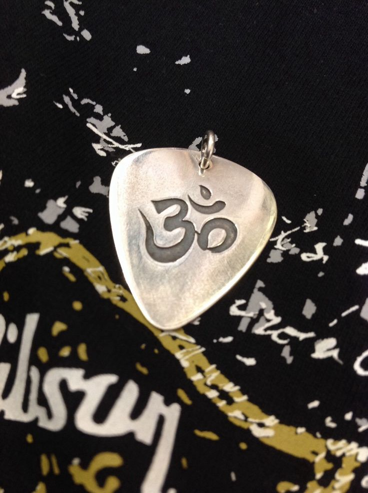 A personal favourite from my Etsy shop https://www.etsy.com/listing/262246865/silver-handmade-guitar-pick-custom-om