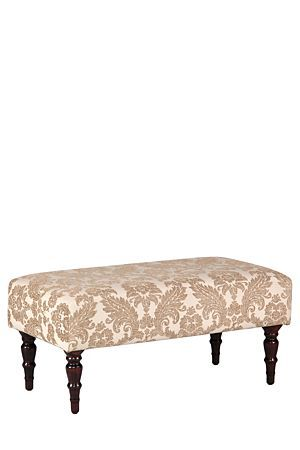 With its classic design and turned leg detail, this ottoman complements a feminine lounge or bedroom.