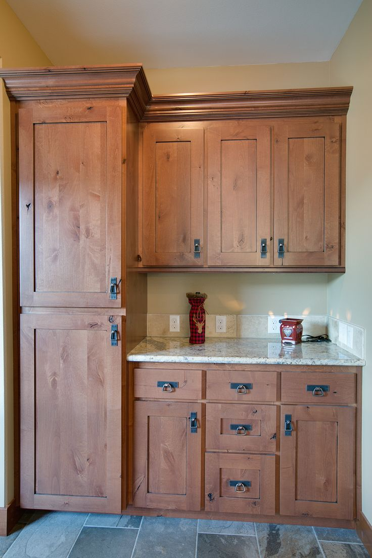 Built in Charging station for guests to stay connected even while disconnecting. Knotty Alder cabinets. #greatnwhomes