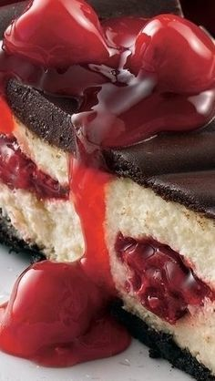 "Chocolate Cherry Cheesecake Recipe ~ Get ready for the ""wow factor"" when you bring out this beautiful dessert. Looks like it took hours to make, but you can be busy with other things while it's baking and chilling."