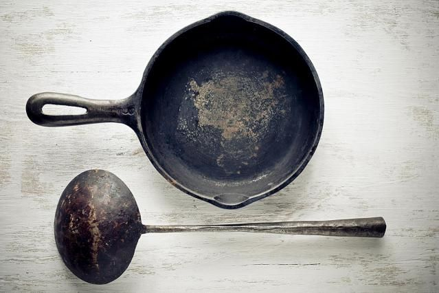 Learn how to clean a rusty, old cast iron pan and then season it to perfection for future cooking.
