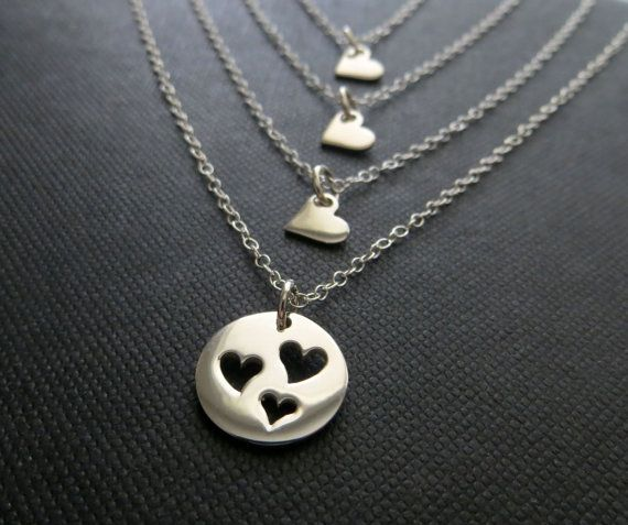 Perfect gift for mother of three. Four separate necklaces featuring sterling silver cut out heart disc for mother and tiny heart necklaces for