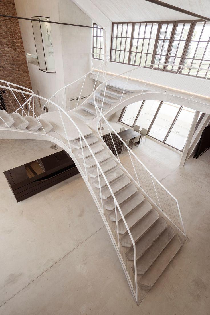 Architectural Details: The Sculptural Concrete Staircase of Loft Panzerhalle - Architizer