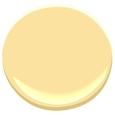Benjamin Moore - Golden Honey 297.  Happy, subtle yellow that works well if the room changes over time.