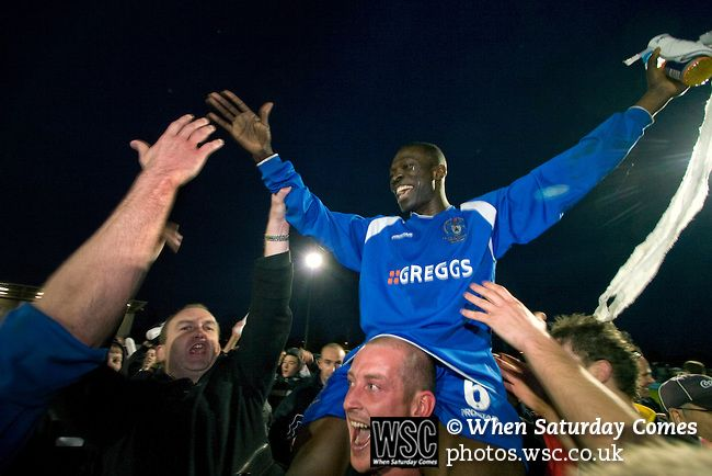 Curzon Ashton v Exeter City, 08/11/2008. FA Cup first round, Tameside Stadium. Goalscorer James Ogoo of Curzon Ashton is carried shoulder high from the pitch by delighted supporters after his side's victory against Exeter City in the FA Cup first round tie at the Tameside Stadium, Ashton-under-Lyne. The home team, who play in the Unibond first division north won the match 3-2 against their opponents from Coca Cola League 2, four divisions above Curzon Ashton. It was the home side's…