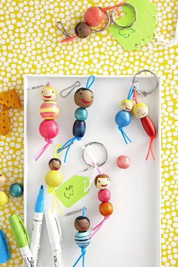 "These adorable key chains can be personalized on the spot. HOW-TO Kids can prepaint a variety of skin tones and hair onto ⅝"", ¾"", and 1"" round wooden beads ($4 per bag; michaels.com). When a customer places an order, your little artist can draw the portrait, including eyes, a mouth, and other features. Then she'll string the finished bead onto plastic lacing looped over a round key ring and add colored beads for the body."