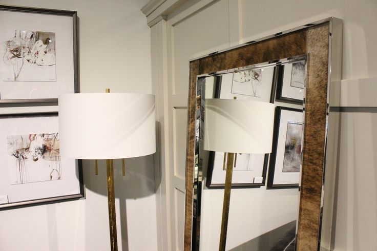 http://www.avenuedesigncanada.com/Barcelona-Cassidy-Floor-Mirror/358-335-P150/ItemInformation.aspx  Cowhide accents on the Cassidy mirror in Montreal Qc at Avenue Design - Shipping to all of North America