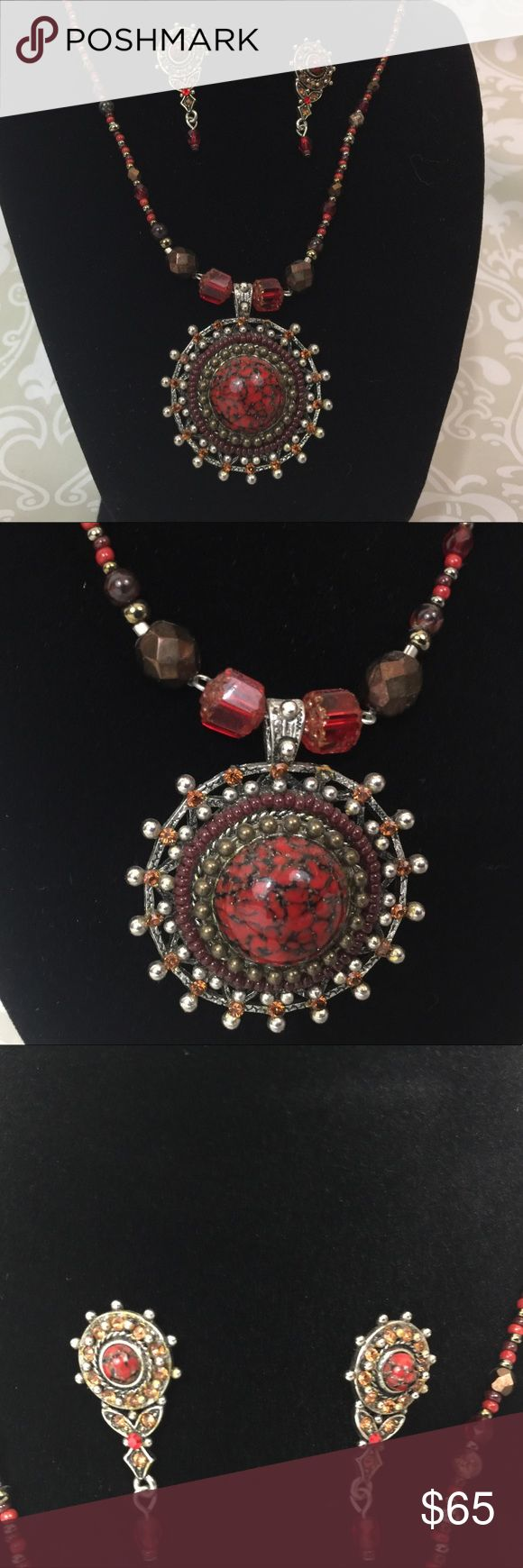 Beautiful F.A.I.T.H. necklace and Earring Set Red and Black Statement Medallion Necklace and Earring Set.   Goes with so much. Colors include red, black, brown, silver. Previously worn, cared for and loved. Excellent condition. Please ask any question you might have.  Reasonable offers welcome.  Bundle for savings.  Thank you for shopping in my closet! Jewelry Necklaces