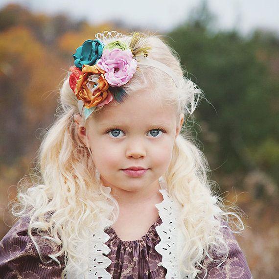 The Autumn Splendor head band, vivid colors on soft flowers and feathers. $27.00, via Etsy.