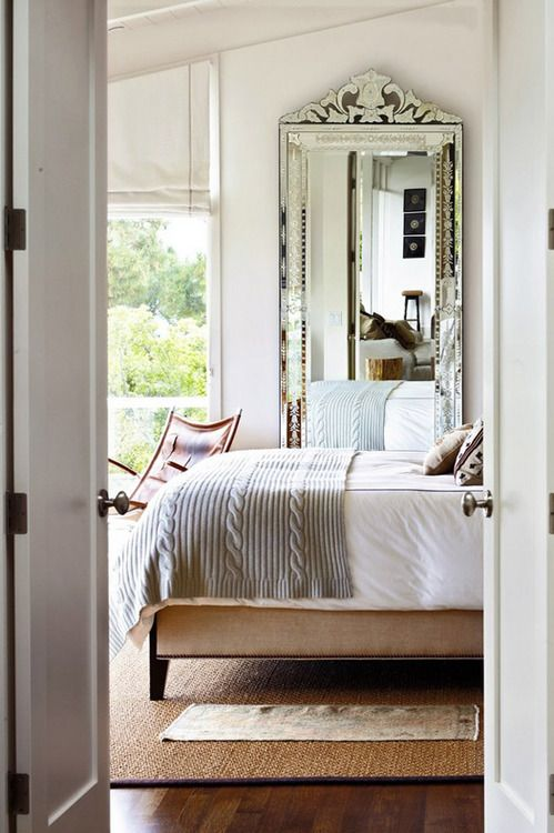 A Glimpse Inside This Master Bedroom Reveals A Linen Upholstered Bed By  Plantation, A Midcentury French Leather Sling Chair, And A Venetian  Cut Glass Mirror ...
