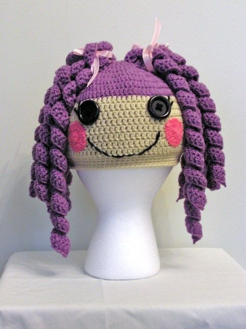 That is some talent!!!... Lalaloopsy Crochet hat~ Link unavailable when I checked on 04/03/2015 But did find a free pattern for this hat on http://www.ravelry.com/patterns/library/lalaloopsy-doll-inspired-hat  ~ LINK CORRECT and pattern is FREE when I checked on 04/03/2015.