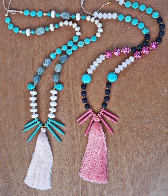 Handmade long beaded silk cord necklace embellished with turquoise howlite gemstones, fuchsia howlite, lava beads. crystal stones and a big light orange tassel . Wear yours to add a statement finish to a simple tee or dress.  The size is adjustable because of the macrame closure.   Our Items are handmade and may have slight variations between the same items. Minor imperfections can be possible on leathers, which is what makes them unique!  Colors may vary slightly on your computer screen…