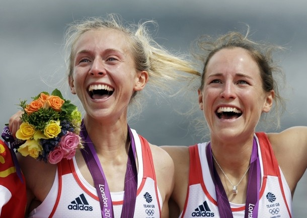 Great Britain's Katherine Copeland, left, and Sophie Hosking celebrate on the podium after winning the gold medal for the lightweight women's rowing double sculls in Eton Dorney, near Windsor, England, at the 2012 Summer Olympics, Saturday, Aug. 4, 2012.