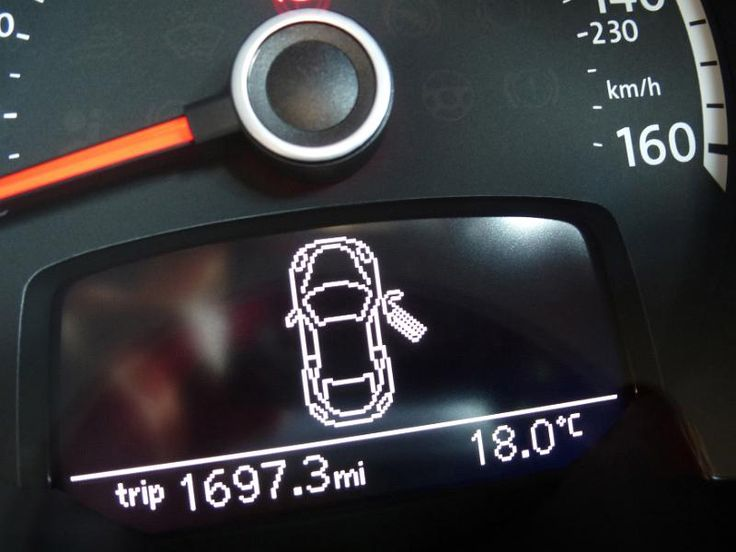 Illuminated information display on a car dashboard showing an open door, the distance travelled and interior temperature - free stock photo from www.freeimages.co.uk