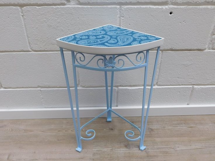 Wrought Iron Quarter Round Side Table £32 Fab wee 1960's Quarter Round Side Table.  Wrought Iron with curved and leaf detail.   Re-sprayed in pale blue with blue and white paisley pattern vinyl top with white acrylic border.  60cm High - 29.5cm Radius     All our items are pre-owned and vintage, so may have light signs of use & wear typical of age.