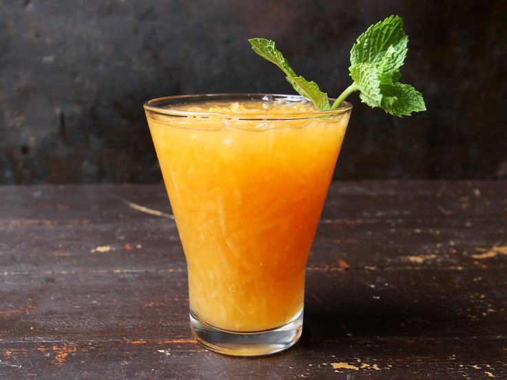 Grated fresh cantaloupe combines with water, sugar, and a little minced fresh mint for a refreshing summer drink.