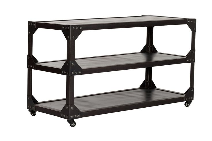 Industrial 3 Tier Shelving Unit -- This Industrial 3 Tier Shelving Unit has a raw, iron feel which screams of industrial revolutions and a time long past.  This classic French vintage industrial shelving unit is constructed of solid steel with three useful shelves, and makes an ideal coffee table, TV stand, occasional table, waiters table or drinks stand.  The raw look will work seamlessly with a variety of decor styles in either home or commercial settings.  The industrial 3 tier shelving…