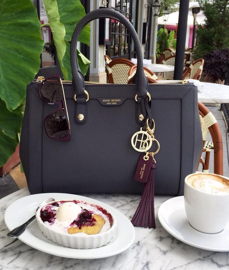 The West 57th Carryall is a luxury handbag that lives up to its name with style and storage to spare. Crafted with pure Saffiano leather and featuring plenty of interior pockets to organize your essentials, this chic designer handbag stands out from the c