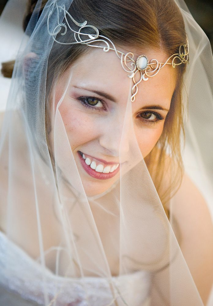 This stunning bride is Shannon, and she opted for a Celtic inspired circlet instead of a traditional headpiece. So pretty, yet unique and reminiscent of the Lord of the Rings headdresses