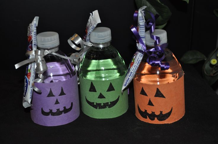 Here is a healthy treat for your kids to take to their school Halloween party. Easy and inexpensive to make. Small water bottles wrapped in construction paper, with an Ocean Spray drink mix packet held on with a ribbon,