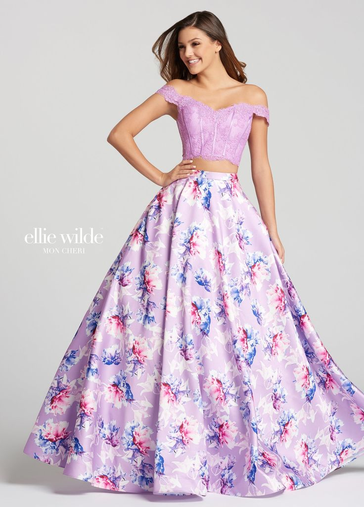 Discover the perfect fusion of mikado and lace in Ellie Wilde EW118178. This lovely two-piece ball gown features an off-the-shoulder, lace sweetheart top, with satin boning detail, and a delicate mesh overlay. The full mikado skirt bursts with a pastel floral print, over the solid color backdrop. This dress will be the best of both worlds at your next sweet sixteen, military ball, or prom.