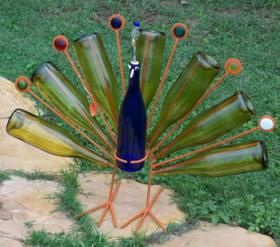 A peacock with wine bottles.