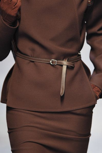 Hermès. Wow! Gives the idea of a peplum without being one. Makes brown look rich. Will be looking for the whole suit.