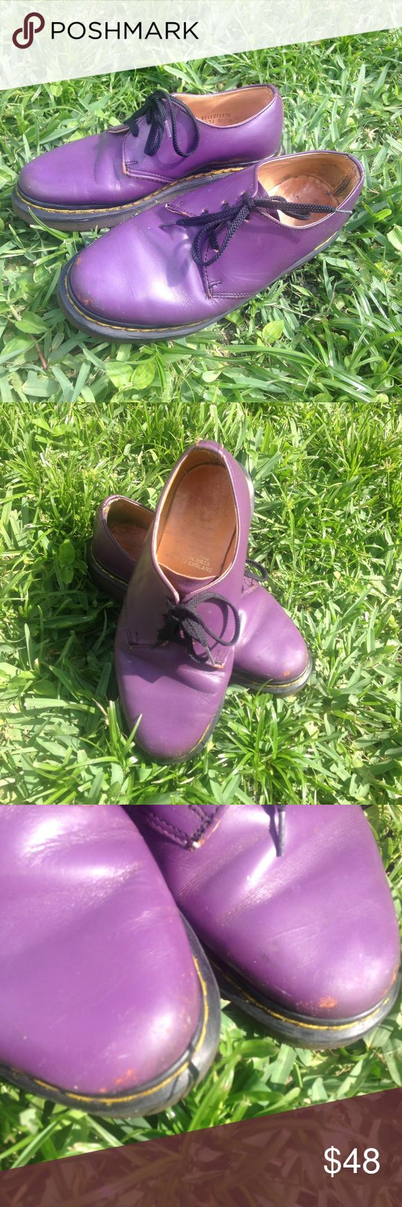 Awesome pair of purple Doc Martens. Awesome pair of purple Doc Martens size 3. They are in good condition with s few scuffs on the toes. These would great with any outfit. No trades or swaps. Doc martens Shoes Lace Up Boots