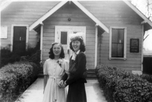 two women in front of house. http://digitallibrary.usc.edu/cdm/ref/collection/p15799coll126/id/15395