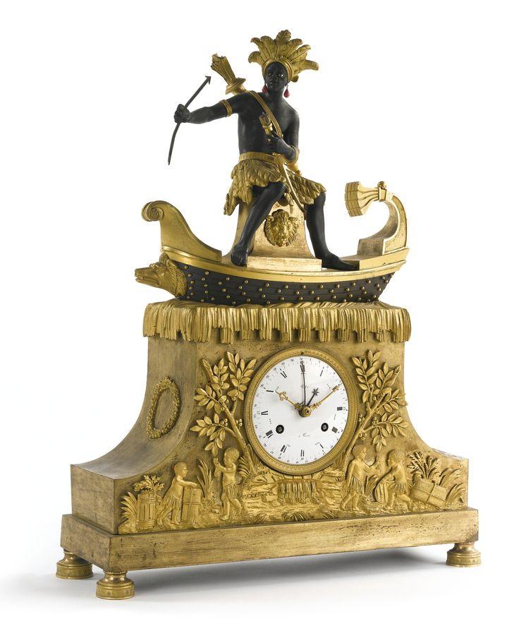 A rare Directoire ormolu and patinated bronze 'bon savage' mantel clock circa 1795, the dial signed Piel à Paris Sotheby's