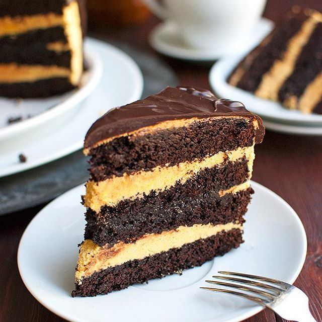 Dark Chocolate Cake with Pumpkin Buttercream and a Salted Caramel Filling! This cake is just…