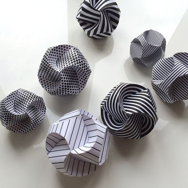 Paper baubles, made by three folded paper strips that almost magically plop in place to form a ball. Learn how to – and get the PDF at my blog.
