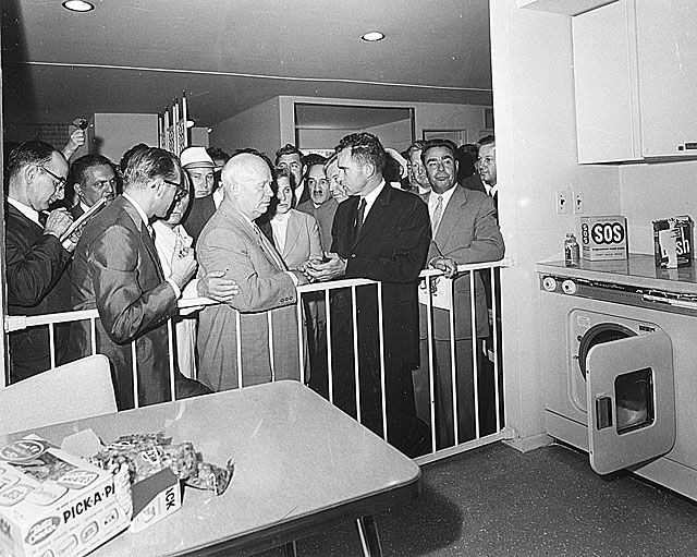 The kitchen debate, Nikita Khruscev and Richard Nixon at the american national exhibition, Moscow, July 1959 - more : http://en.wikipedia.org/wiki/Kitchen_Debate