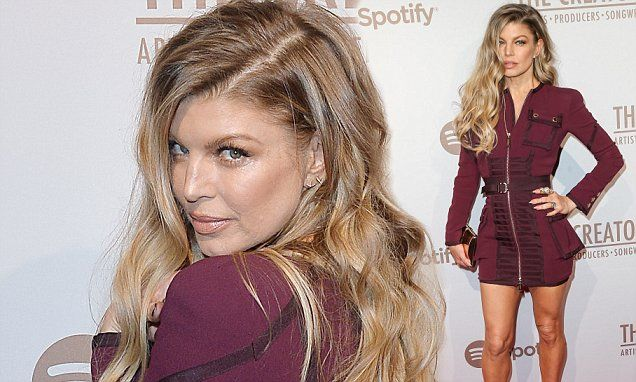 Fergie covers up her Humps in trendy burgundy dress at Spotify bash