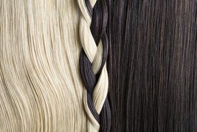 Still life of blond and brown hair, braided. - Andreas Kuehn/ Stone/ Getty Images