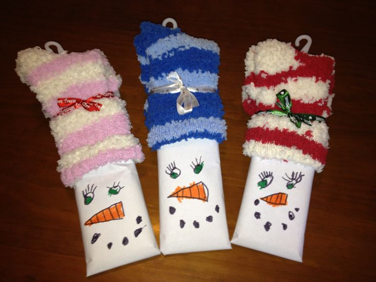 Teacher Gift Christmas Craft  My son and I made these for his preschool teachers.  We wrapped a jumbo candy bar in paper, drew faces, and topped with super-fuzzy socks.  Tied with a ribbon for a cute finishing touch!