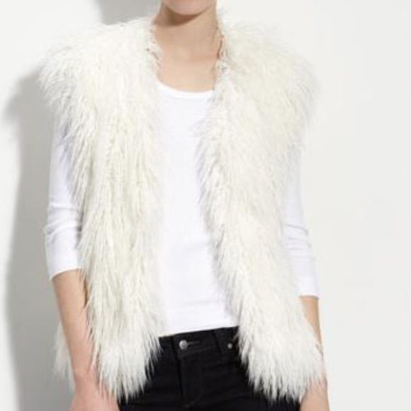 White Fur Vest Xhilaration sz M FAUX Hardly ever worn, this furry/fuzzy white vest is super cute for adding to a boring outfit! Purchased from Target, size medium, no holes stains or tears, no fur coming out. Flatters my body but clashes with my white blonde hair. Make an offer  Xhilaration Jackets & Coats Vests