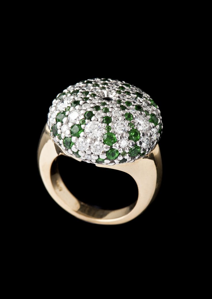 What a treasure this 18ct white and yellow gold ring from our 'Kina' collection is encrusted  with diamonds and tsavorite garnets. But what's inside?