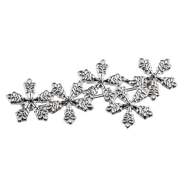 SNOW CRYSTAL BROOCH by Finnish jewelry company Kalevala Koru. Designer: Terhi Koivisto, material: silver