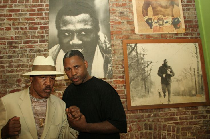 """Joe """"Smokin' Joe"""" Frazier was born in South Carolina.He left at the age of 16 and moved first to New York and then Philadelphia, escaping the poverty and segregation of the South to pursue his dream to box. He won the Gold Medal in the heavy-weight division at the 1964 Summer Olympics in Tokyo, turned pro and went on to hold the heavyweight title, defeating Muhammad Ali in the """"Fight of the Century"""" in 1971. After retiring, he opened Joe Frazier's Gym in Philadelphia."""