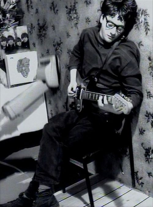 Graham Coxon in the video for Bang. Great records behind him too.
