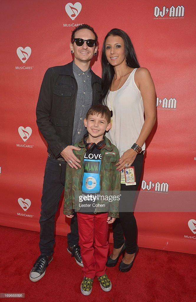 Musician Chester Bennington, son Tyler Lee Bennington, and wife Talinda Ann Bentley attend the 2013 MusiCares MAP Fund Benefit Concert honoring Chester Bennington and Tony Alva at Club Nokia on May 30, 2013 in Los Angeles, California.