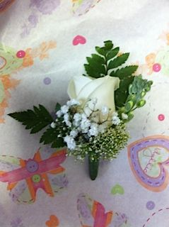 Cream rose with hint of baby's breath and leather leaf buttonhole