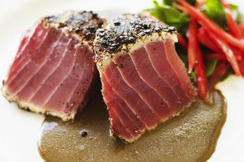 These spice-rubbed seared ahi tuna steaks are easy to make and take just a few minutes to cook. Add the balsamic reduction sauce and you're good to go.
