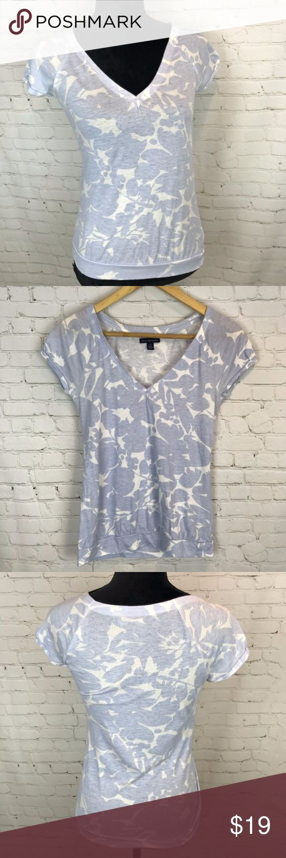 American Eagle Floral V-Neck Blue & White T-Shirt This American Eagle Outfitters top would look great for work, with a pencil shirt and heels, or paired with a pair of jeans and flats for hanging out in the weekend. The fit is very flattering. Preowned from a smoke free home, in very good used condition, with owner's name written on the inside but not visible when wearing. Check out the rest of my closet to create your own custom bundle. American Eagle Outfitters Tops Tees - Short Sleeve