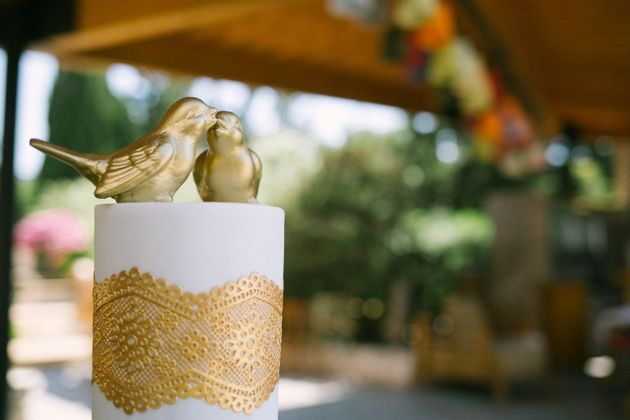 White and gold wedding cake. Golden lace and love birds topper. By Stella and Moscha Weddings. Photo by Adrian Wood
