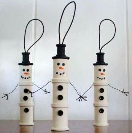 Use empty thread spools to create little snowmen ornaments!