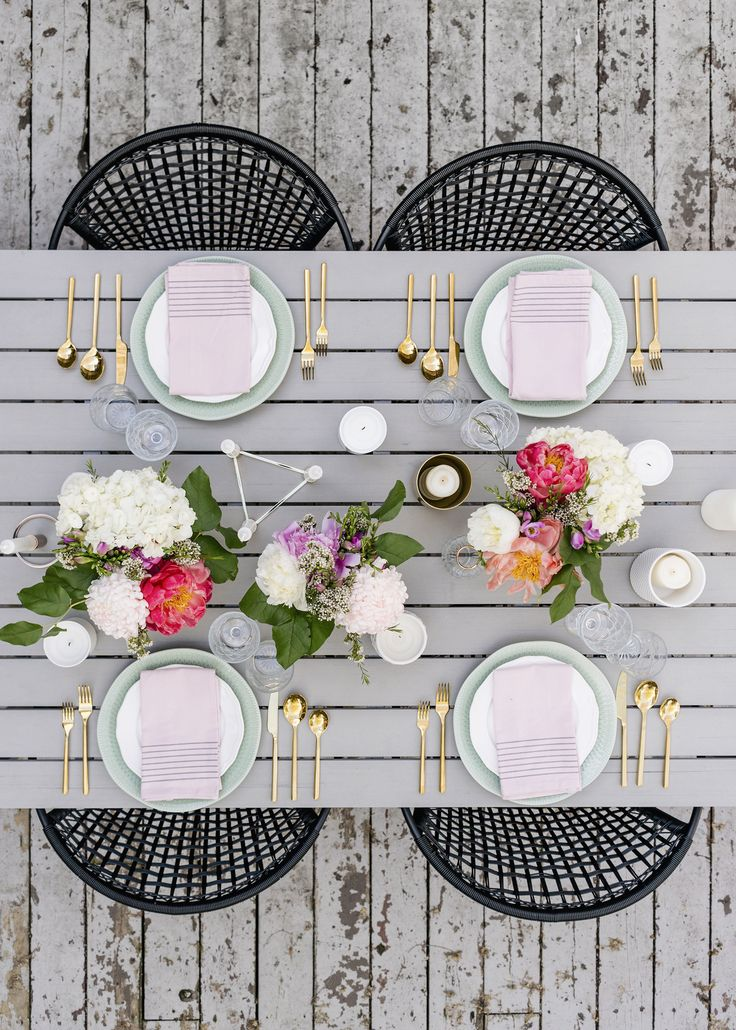 Modern romantic spring tablescape with pastel placesettings, gold cutlery + fresh peonies