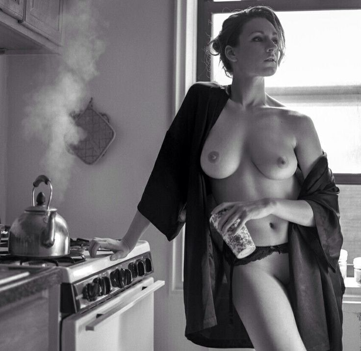 nude woman drinking coffee kitchen