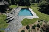 Swimming Pool with retractable cover inset in sides